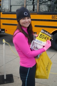 Cindy Fuke waits to board the bus for the start of the 113th Boston Marathon