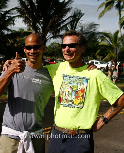 Eddie Ombac, left, celebrates finishing the Hilo Marathon