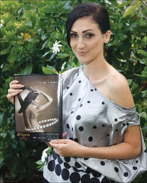 Big Island-born Jaclynn Joseph, now working as an international fashion model based in Taiwan, holds a copy of the current issue of Big Island Visitor magazine, in which her image graces the back cover. She's a Waiakea High grad and holds a BA in history from the University of Hawaii at Hilo. - William Ing/ Tribune-Herald