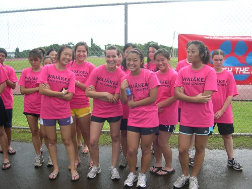 Waiakea girls show their muscle while waiting for the presentation of awards