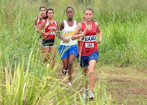 Keaau freshman, Natalie Hagemann, leads a pack of girls at CLA.  Photo by Brad Ballesteros