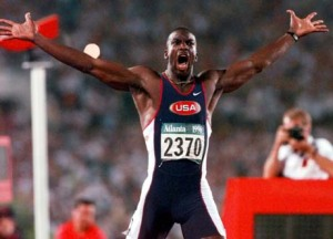 Michael Johnson celebrates after his world record 19.32 seconds in the 200.  Usain Bolt of Jamaica ran a 19.19 in August