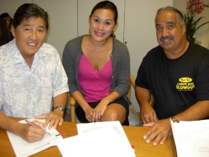 Jerry Chang, Kimberly Shimabuku and Ellsworth Fontes sign contract